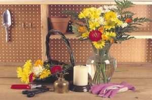 A potting bench holds flower cut from a home garden and tools and implements needed to arrange them in a floral display. Copyright ©2002 by Dolezal & Associates. All Rights Reserved. grownbyyou.com